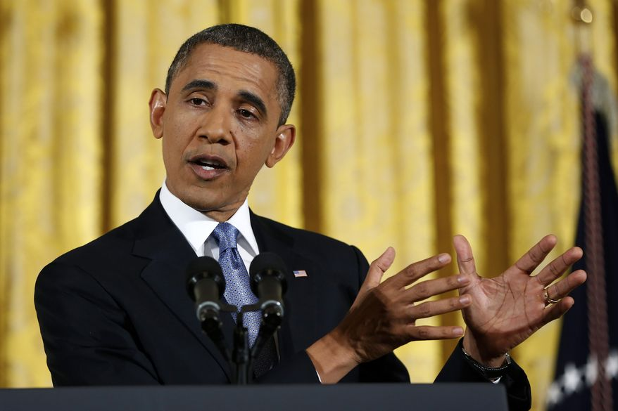 President Obama gestures as he answers a question during a news conference in the East Room of the White House in Washington on Wednesday, Nov. 14, 2012. (AP Photo/Carolyn Kaster)