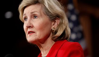 ** FILE ** Then-Sen. Kay Bailey Hutchison, Texas Republican, speaks about financial reform on Capitol Hill in Washington on Wednesday, April 21, 2010. (AP Photo/Charles Dharapak)
