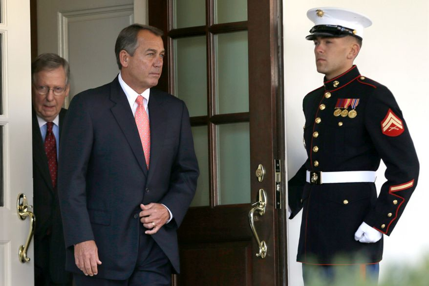 House Speaker John Boehner of Ohio, center, followed by Senate Minority Leader Mitch McConnell of Ky., leaves the White House the White House in Washington, Friday, Nov. 16, 2012, to speak to the media after meeting with President Barack Obama to discuss the economy and the deficit. (AP Photo/Jacquelyn Martin)