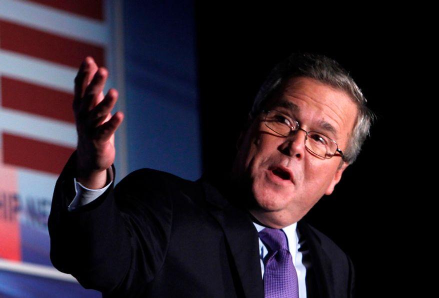 ** FILE ** This Jan. 26, 2012, photo shows former Florida Gov. Jeb Bush speaking in Miami. (AP Photo/Wilfredo Lee)