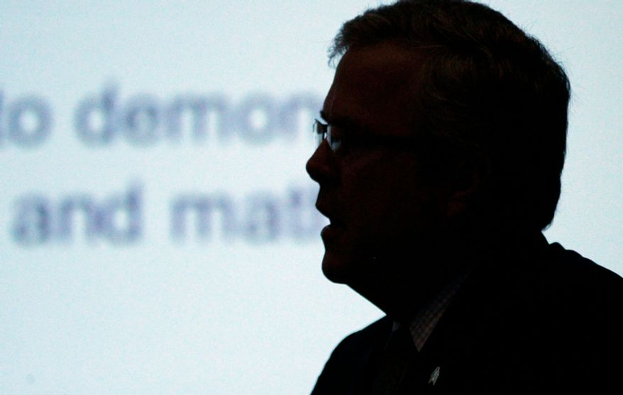 Former Florida Gov. Jeb Bush casts a silhouette against the projector screen as he and Mississippi Gov. Phil Bryant discuss the importance of pursuing education reforms, especially charter schools, during an education policy forum hosted by the Mississippi Center for Public Policy and Mississippi First at the Old Capitol in Jackson, Miss., on Tuesday, Aug. 7, 2012. (AP Photo/Rogelio V. Solis)