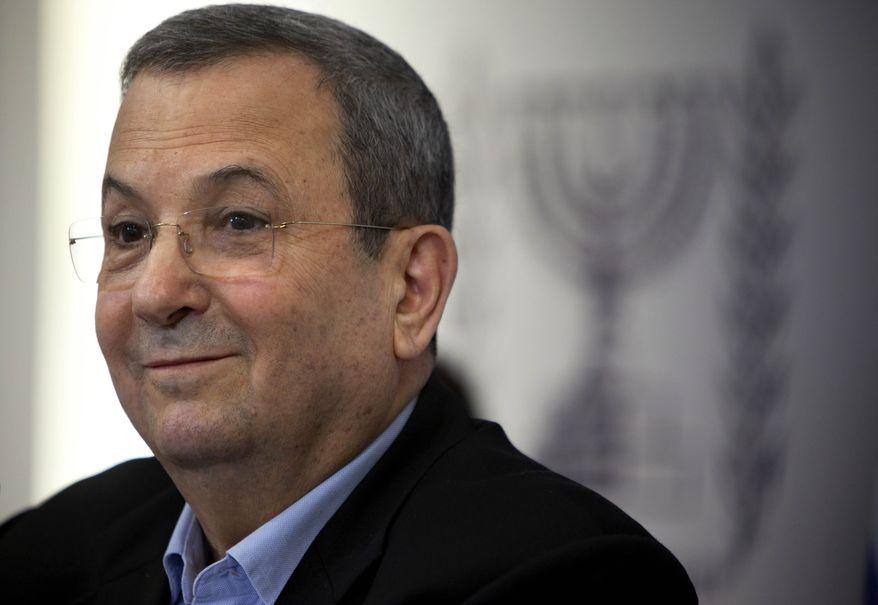 Israeli Defense Minister Ehud Barak speaks to the media in Tel Aviv on Monday, Nov. 26, 2012. (AP Photo/Oded Balilty)
