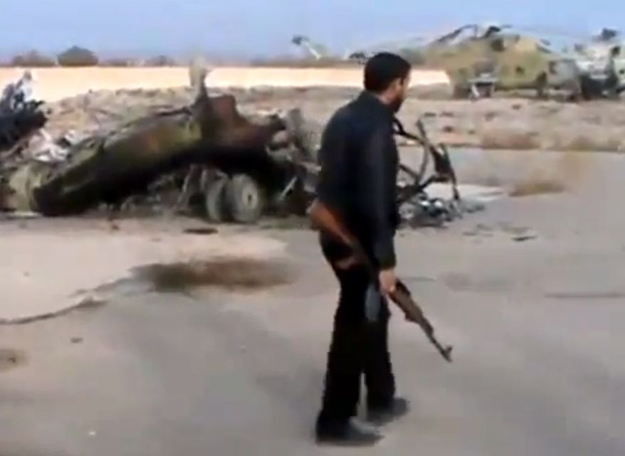 In this image taken from video, which has been authenticated based on its contents and other AP reporting, Syrian rebels capture a helicopter air base near Damascus, Syria, the capital, after fierce fighting on Sunday, Nov. 25, 2012. (AP Photo/Ugarit News via AP video)