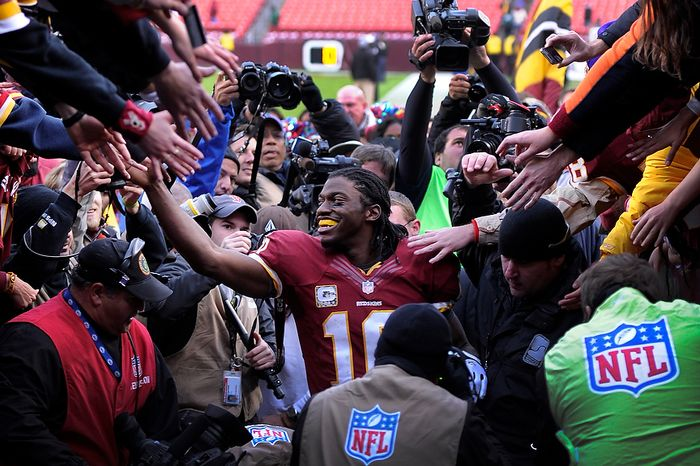 Washington Redskins quarterback Robert Griffin III (10) leaves the field surrounded by fans and the media after defeating the Philadelphia Eagles 31-6 at FedEx Field in Landover, Md., on Sunday, Nov. 18, 2012. (Preston Keres/Special to The Washington Times)