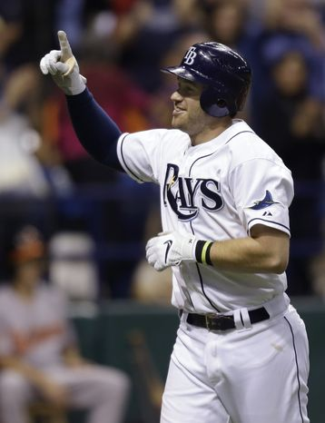 FILE - This oct. 3, 2012 file photo shows Tampa Bay Rays' Evan Longoria reacting after hitting a sixth-inning home run off Baltimore Orioles relief pitcher Jake Arrieta during a baseball game in St. Petersburg, Fla. Longoria has agreed to a new contract through 2022 that adds six guaranteed seasons and $100 million. The agreement announced Monday, Nov. 26, 2012 with the three-time All-Star incorporates the remainder of the 27-year-old's existing contract, which called for him to earn about $36.5 million over the next four seasons.  (AP Photo/Chris O'Meara, File)