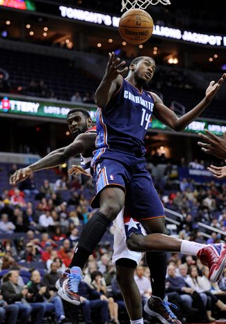 Washington Wizards forward Chris Singleton, left, gets entangled with Charlotte Bobcats forward Michael Kidd-Gilchrist (14) during the second half of an NBA basketball game on Saturday, Nov. 24, 2012, in Washington. Charlotte won 108-106 in double overtime. (AP Photo/Nick Wass)