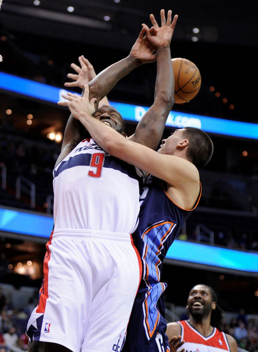 Washington Wizards forward Martell Webster (9) and Charlotte Bobcats center Byron Mullens battle for the ball during the first overtime period of an NBA basketball game on Saturday, Nov. 24, 2012, in Washington. Charlotte won 108-106. (AP Photo/Nick Wass)