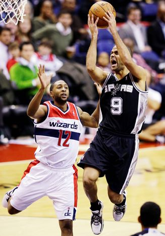 associated press  San Antonio guard Tony Parker shoots past Washington guard A.J. Price on Monday night. Parker (15 points) was one of seven Spurs to score in double figures.