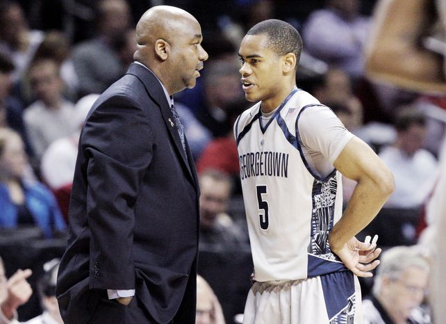 Georgetown coach John Thomson III talks strategy with guard Markel Starks, who enjoys the up-tempo approach, as does wingman Greg Whittington. The Hoyas are averaging 68.6 possessions a game. (Associated Press)