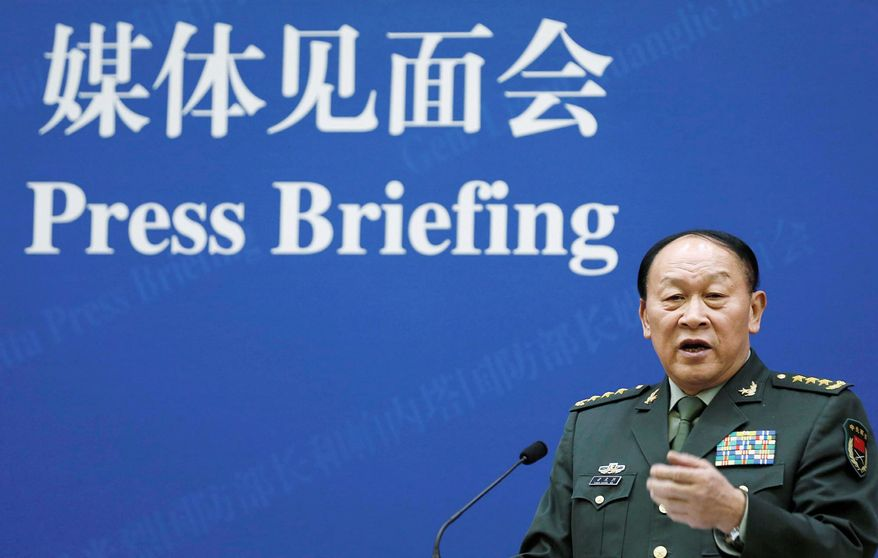 China's Defense Minister Liang Guanglie speaks at a news conference with U.S. Defense Secretary Leon Panetta, not seen, at the Bayi Building in Beijing, China Tuesday, Sept. 18, 2012. (AP Photo/Larry Downing, Pool)