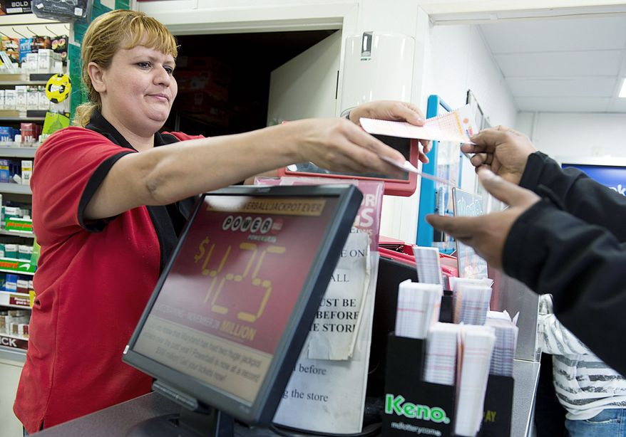Glendy Sanabria sells Powerball tickets at a 7-Eleven in Beltsville on Tuesday, one day ahead of the drawing for more than $500 million. A lot of people in the District, Maryland and Virginia just know that their lottery ticket is the lucky one. (Barbara L. Salisbury/The Washington Times)