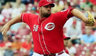 Cincinnati Reds relief pitcher Jonathan Broxton throws against the Milwaukee Brewers in the ninth inning of a baseball game, Thursday, Sept. 27, 2012, in Cincinnati. Broxton was the winning pitcher in their 2-1 victory. (AP Photo/Al Behrman)