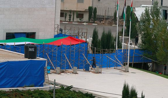 Blue tarp covers the entrance to Yasser Arafat's mausoleum in the West Bank city of Ramallah. The remains of the late Palestinian leader Yasser Arafat were exhumed from his grave on Tuesday so international forensic experts could search for additional clues to his death, Palestinian officials said. (AP Photo/Nasser Shiyoukhi)