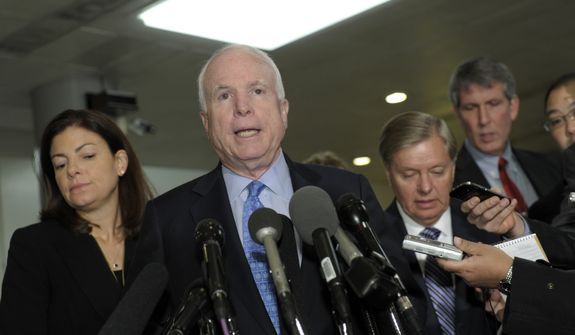 Sen. John McCain (center), ranking Republican on the Senate Armed Services Committee, flanked by Sen. Kelly Ayotte (left) and Sen. Lindsey Graham, who are fellow committee members, speaks on Capitol Hill in Washington on Tuesday, Nov. 27, 2012, following a meeting with U.N. Ambassador Susan Rice. Ms. Rice met with the lawmakers to discuss statements she made about the attack on the U.S. Consulate in Libya that left the ambassador and three other Americans dead. (AP Photo/Susan Walsh)