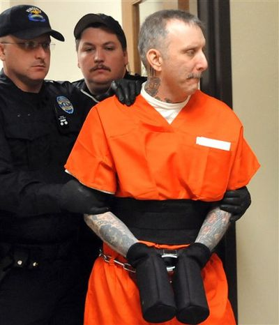 ** FILE ** In this Tuesday Jan. 25. 2012 photo, Robert Gleason Jr. is escorted into a Wise County courtroom in Wise, Va. An execution date of Jan. 16, 2013 has been set for Gleason, who strangled two inmates in the state's highest security prisons and vowed to keep killing unless he was put to death. (AP Photo/Bristol Herald Courier, David Crigger, File)