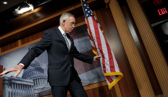 Senate Majority Leader Harry Reid, Nevada Republican, leaves the podium after a news conference on Capitol Hill in Washington on Wednesday, Nov. 7, 2012, during which he talked about the election. (AP Photo/Susan Walsh)