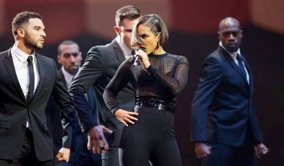 U.S. singer Alicia Keys performs during the 2012 MTV European Music Awards show at the Festhalle in Frankfurt, central Germany, Sunday, Nov. 11, 2012. (AP Photo/Michael Probst)