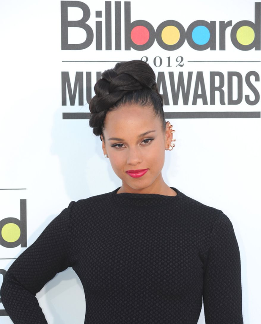 In this photo provided by the Las Vegas News Bureau, singer Alicia Keys walks the red for the 2012 Billboard Music Awards at the MGM Grand on the Las Vegas Strip. Sunday, May 20, 2012. (AP Photo/Las Vegas News Bureau, Glenn Pinkerton)