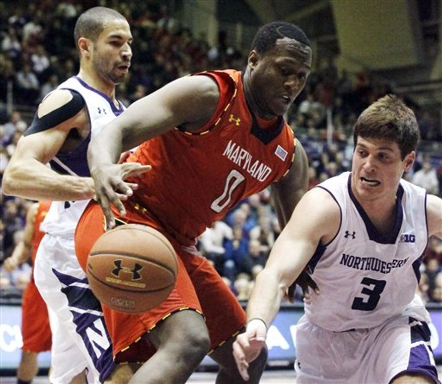 Northwestern guard Dave Sobolewski (3) knocks the ball out of the hands of Maryland forward Charles Mitchell (0) as Northwestern forward Drew Crawford defends during the first half of an NCAA basketball game, Tuesday, Nov. 27, 2012, in Evanston, Ill. (AP Photo/Charles Rex Arbogast)