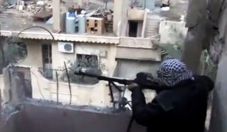 In this image taken from video that has been authenticated based on its contents and other AP reporting, a Syrian rebel fires his weapon during clashes with government forces in Aleppo, Syria, on Monday, Nov. 27, 2012. (AP Photo/Shaam News Network via AP video)