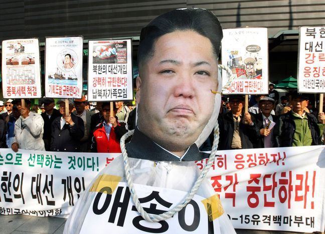 """A cutout of North Korean leader Kim Jong-un is displayed during a protest denouncing North Korea for trying to intervene in the upcoming South Korean presidential election scheduled for Dec. 20, in Seoul on Friday, Oct. 12, 2012. The cutout reads """"Novice."""" (AP Photo/Ahn Young-joon)"""