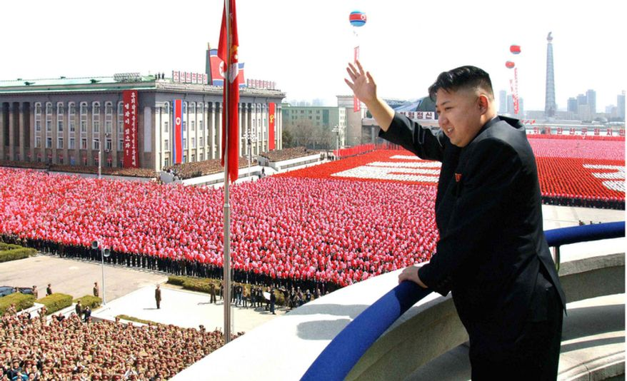 In this Sunday, April 15, 2012, photo released by the Korean Central News Agency and distributed by the Korea News Service on April 16, 2012, North Korean leader Kim Jong-un acknowledges cheers during a mass military parade in Pyongyang's Kim Il-sung Square to celebrate the centenary of the birth of his grandfather, national founder Kim Il-sung, in Pyongyang, North Korea. (AP Photo/Korean Central News Agency via Korea News Service)