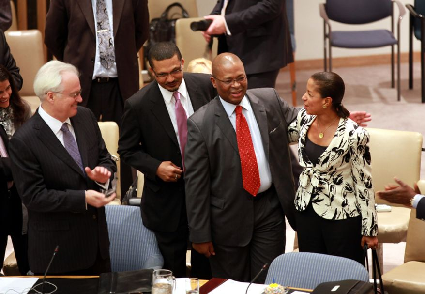 """Russian Ambassador Vitaly Churkin (left) and Susan Rice (right), U.S. ambassador to the United Nations, surprise South African Ambassador Baso Sangqu (second from right) with """"Happy Birthday"""" before members of the U.N. Security Council voted unanimously on Saturday, April 21, 2012, to adopt the Syria Observer Mission Resolution, authorizing 300 observers to be sent to Syria. (AP Photo/David Karp)"""