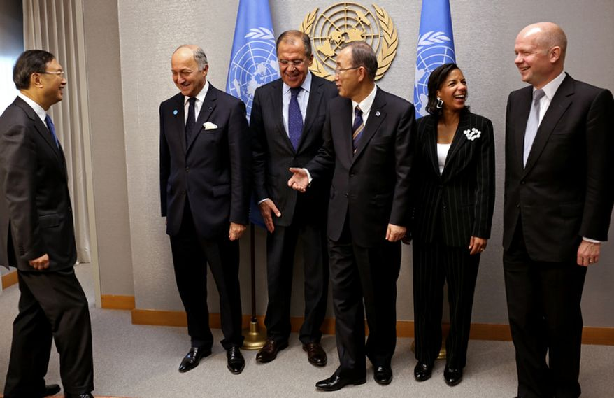 A group of what is known as P-5 leaders share a lighter moment after posing for a photo at the 67th session of the U.N. General Assembly at the world body's headquarters on Thursday, Sept. 27, 2012. From left are Chinese Foreign Minister Yang Jiechi, French Foreign Minister Laurent Fabius, Russian Foreign Minister Sergey Lavrov, U.N. Secretary-General Ban Ki-moon, U.S. Ambassador to the United Nations Susan Rice, and British Foreign Minister William Hague. (AP Photo/Craig Ruttle)