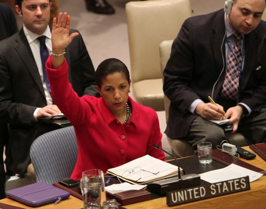 Susan Rice, U.N. ambassador to the United Nations, votes to support a Security Council resolution backing an Arab League call for Syrian President Bashar Assad to step down, at the world body's headquarters on Saturday, Feb. 4, 2012. The unusual weekend session came as Syrian forces pummeled the city of Homs with mortars and artillery in what activists are calling one of the bloodiest episodes of the uprising. (AP Photo/Mary Altaffer)