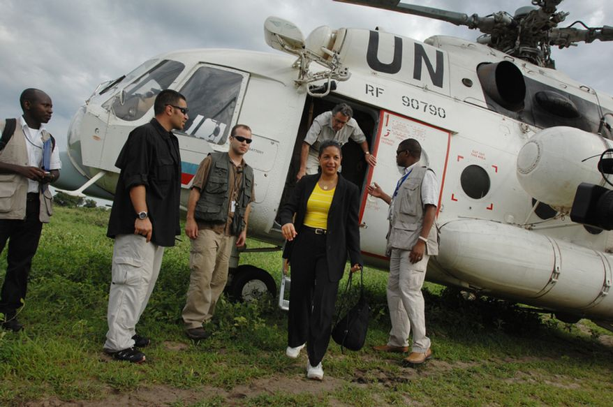 """In this photo released by the United Nations Mission in Sudan (UNMIS), U.N. Security Council delegation members Susan Rice (center), U.S. ambassador to the United Nations, and Nestor Osorio (leaving helicopter) of Columbia arrive in Malau, Sudan, on Tuesday, May 24, 2011. Seventy northern Sudanese troops were killed and more than 120 are missing from an attack last week by southern Sudanese forces near the disputed region of Abyei, a Sudanese diplomat said Tuesday, while Ms. Rice called the incident a """"serious violation"""" of the peace agreement. (AP Photo/UNMIS, Paul Banks)"""