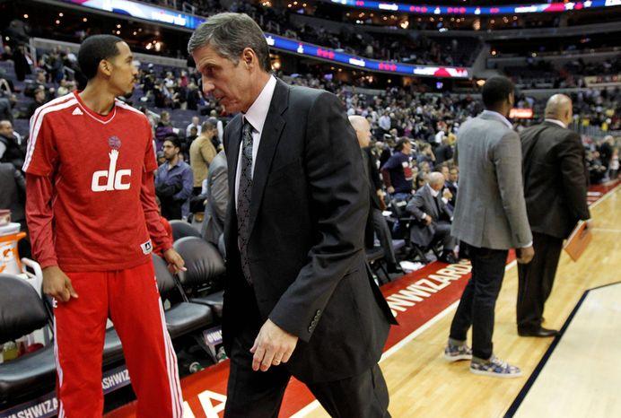 Washington Wizards head coach Randy Wittman walks off the court after of an NBA basketball game against the San Antonio Spurs Monday, Nov. 26, 2012, in Washington. The Spurs won 118-92. The Wizards are now 0-12. (AP Photo/Alex Brandon)
