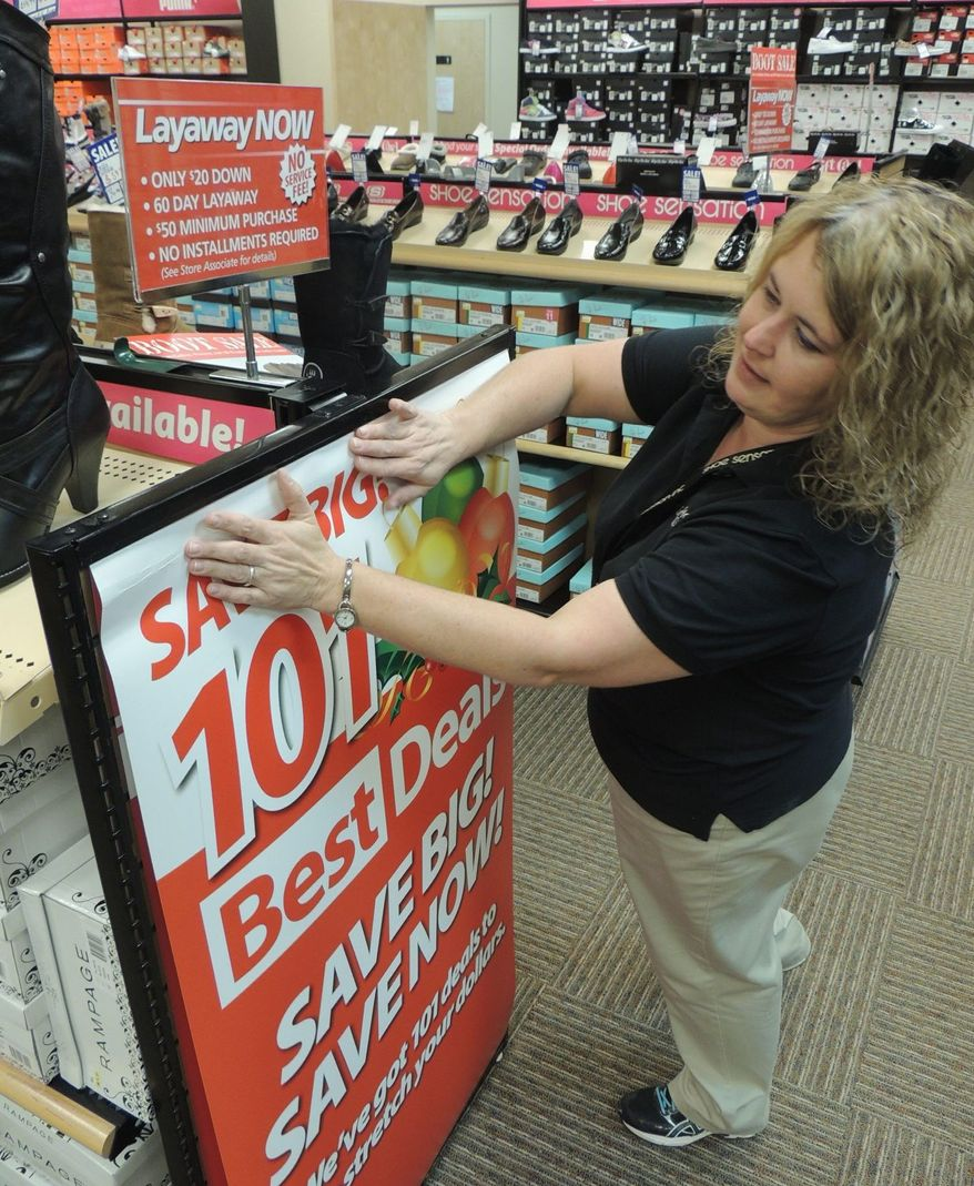 Linda Childress, store manager at Shoe Sensation in Grundy, Va.  (Debra McCown/Special to the Washington Times)