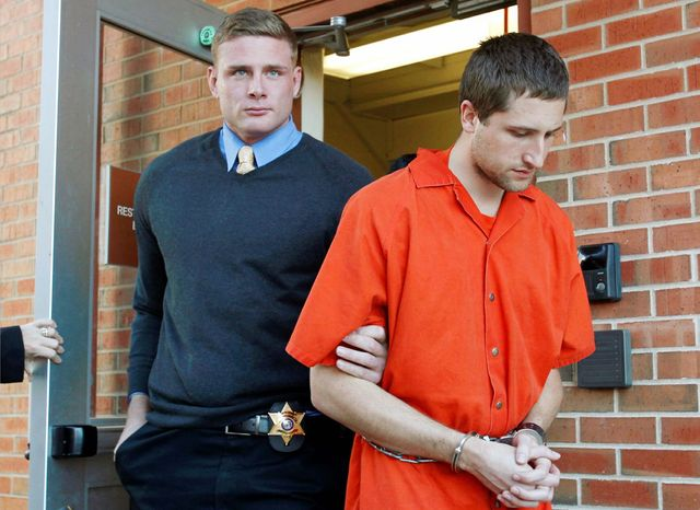 Micah Moore, 23, is shown being escorted into the Jackson County Courthouse Annex in Independence, Mo., earlier this month. His attorney has withdrawn his confession to killing Bethany Ann Deaton. A preliminary hearing planned for Wednesday was put off and the case will go to a grand jury. (The Kansas City Star via Associated Press)