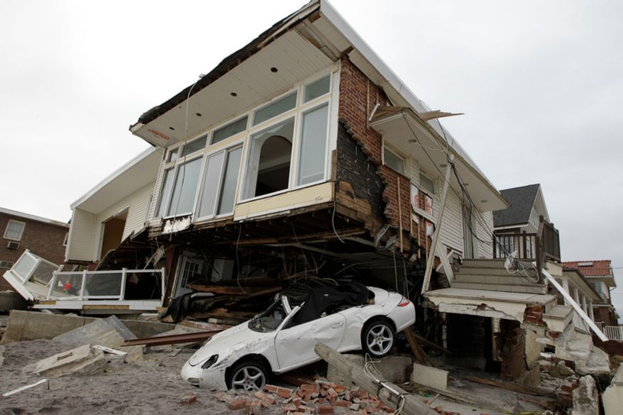 A beachside house, deemed uninhabitable by the New York City Department of Buildings, is left in ruins in the Belle Harbor neighborhood of the Rockaways in the New York borough of Queens on Monday, Nov. 19, 2012. (AP Photo/Kathy Willens)