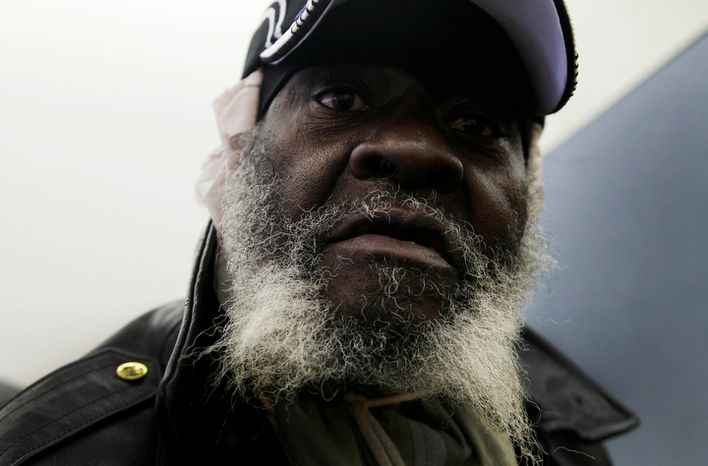Paul Hunter, whose home was flooded in superstorm Sandy, waits for assistance at an NYC Restore location in the Far Rockaway section of the New York borough of Queens on Tuesday, Nov. 13, 2012. (AP Photo/Mark Lennihan)