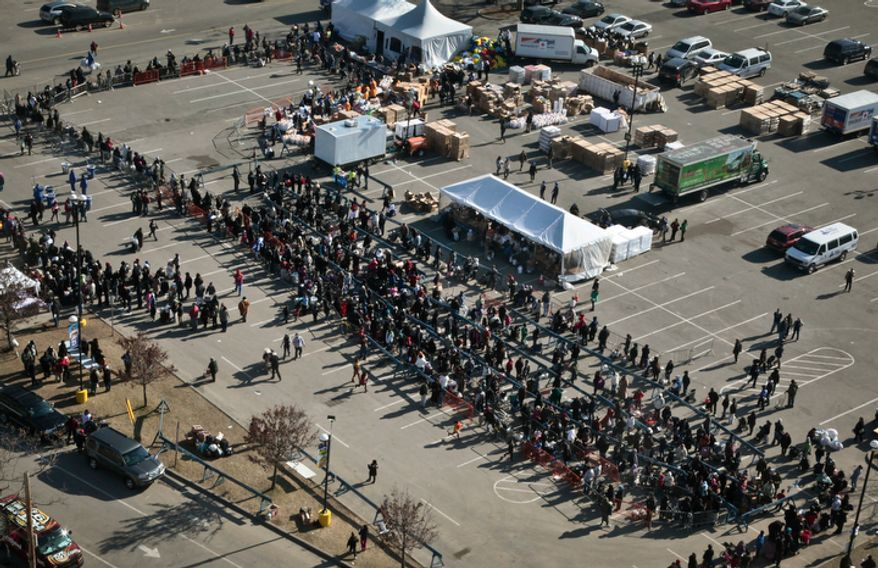 Hundreds who were affected by superstorm Sandy wait in line for distributions from the Federal Emergency Management Agency, the Red Cross and other aid organizations on Saturday, Nov. 17, 2012, in the Coney Island section of the Brooklyn borough of New York. (AP Photo/Bebeto Matthews)