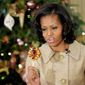** File ** First lady Michelle Obama shows the lollipop she decorated during a holiday decoration preview at the White House in Washington, Wednesday, Nov. 28, 2012. (Associated Press)