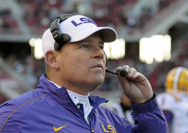 LSU coach Les Miles watches during NCAA college football game against Arkansas in Fayetteville, Ark., Friday, Nov. 23, 2012. LSU won 20-13. (AP Photo/David Quinn)