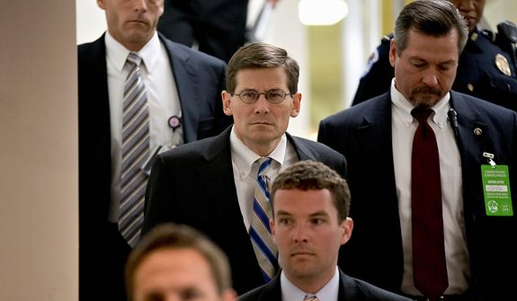 Acting CIA Director Michael Morell, center, arrives on Capitol Hill in Washington, Tuesday, Nov. 27, 2012,  for a closed-door meeting with UN Ambassador Susan Rice who could find her name in contention as early as this week to succeed Hillary Rodham Clinton as secretary of state. Rice has been criticized by some GOP senators for her comments following the deadly Sept. 11 attack on a U.S. consulate in Libya. (AP Photo/J. Scott Applewhite)