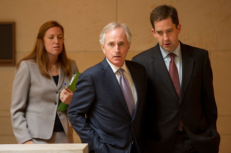 Sen. Bob Corker (R-Tenn), center, leaves after meeting with U.N. Ambassador Susan Rice in the Senate Visitors Center on Capitol Hill, Washington, D.C., Wednesday, November 28, 2012. (Andrew Harnik/The Washington Times)