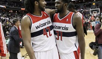 Washington Wizards center Nene, left, and forward Chris Singleton celebrate in the closing moments of an NBA basketball game against the Portland Trail Blazers on Wednesday, Nov. 28, 2012, in Washington. The Wizards won for the first time this season, 84-82. (AP Photo/Alex Brandon)