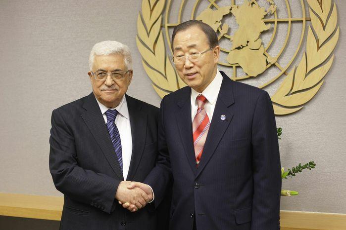U.N. Secretary General Ban Ki-moon, right, shakes hands with Palestinian President Mahmoud Abbas at U.N. headquarters Wednesday, Nov. 28, 2012. (AP Photo/Frank Franklin II)