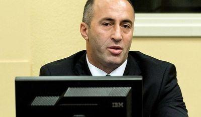 Former Kosovo Prime Minister Ramush Haradinaj awaits his verdict at the courtroom of the Yugoslav war crimes tribunal in The Hague, Netherlands, Thursday, Nov. 29, 2012. (AP Photo/Koen van Weel, Pool)