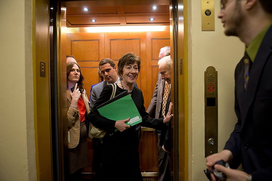 Sen. Susan Collins, center, ranking member of the Homeland Security and Governmental Affairs Committee, gets into an elevator at the U.S. Capitol after talking to the media following a closed-door briefing on the Benghazi attack on Thursday, Nov. 29, 2012. (Barbara L. Salisbury/The Washington Times)