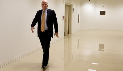 Sen. John McCain, a member of the Homeland Security and Governmental Affairs Committee, leaves a meeting room in the Capitol Visitors Center Thursday, Nov. 29, 2012 following a closed-door briefing on the Benghazi attack. (Barbara L. Salisbury/The Washington Times)