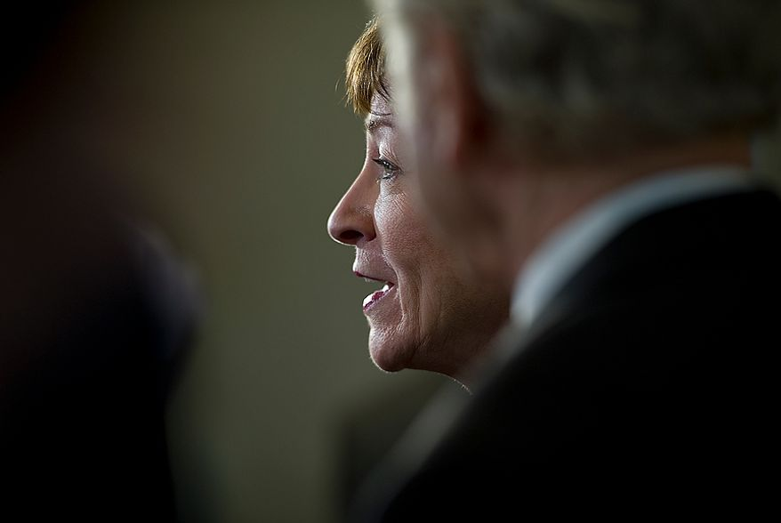 Sen. Susan Collins, ranking member of the Homeland Security and Governmental Affairs Committee, talks to the media following a closed-door briefing about the Benghazi attack on Thursday, Nov. 29, 2012 at the U.S. Capitol. (Barbara L. Salisbury/The Washington Times)