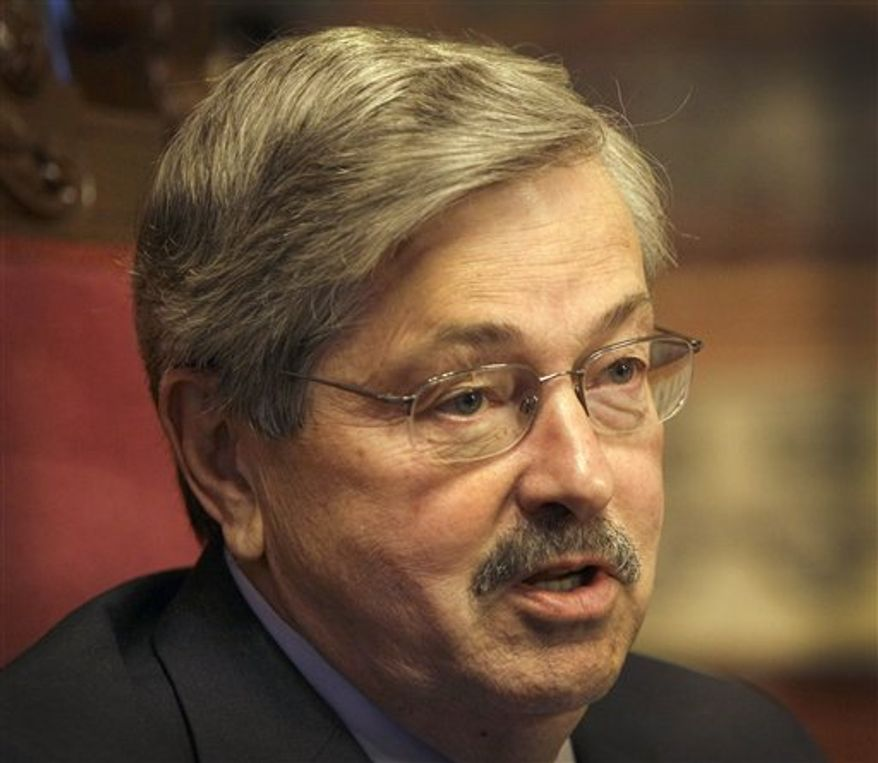 ** FILE ** Iowa Gov. Terry Branstad speaks during an interview with The Associated Press, in this May 11, 2011 photo. The Iowa straw poll has devolved into a full-blown sideshow, Branstad and other critics contend. They say it's an unfair and false test that has felled good candidates and kept others from competing in the state. (Associated Press)