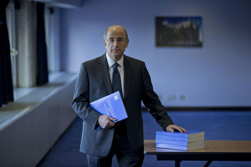 Lord Justice Brian Leveson holds a summary of his report into the culture and practices of the British press and his recommendations for future regulation, on Thursday, Nov. 29, 2012, at the Queen Elizabeth II Conference Centre in London. (AP Photo/Matt Dunham)