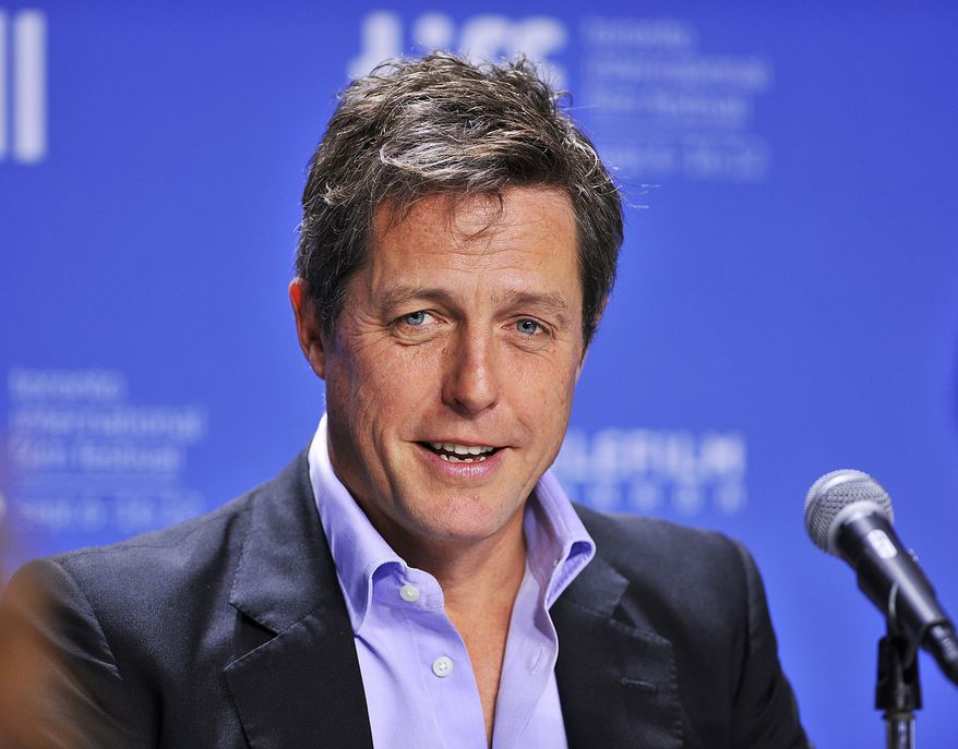 """** FILE ** In this Sept. 9, 2012, file photo, actor Hugh Grant speaks during the news conference for the film """"Cloud Atlas"""" during the 2012 Toronto International Film Festival in Toronto. (AP Photo/The Canadian Press, Aaron Vincent Elkaim, File)"""