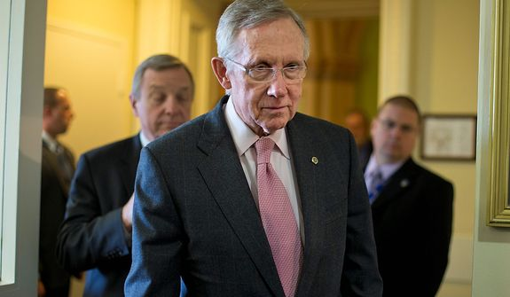 "Senate Majority Leader Harry Reid (center), Nevada Democrat, followed by Sen. Richard J. Durbin (left), Illinois Democrat, arrives for a news conference on Capitol Hill in Washington on Thursday, Nov. 29, 2012, following a meeting with Treasury Secretary Timothy F. Geithner on the ""fiscal cliff"" negotiations. (AP Photo/J. Scott Applewhite)"